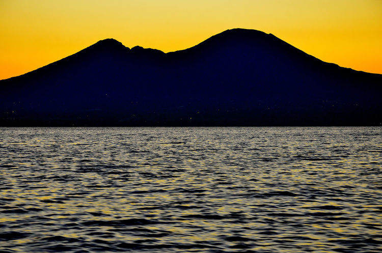 Italia Naples, Italy Napoli Vesuvio Beauty In Nature Campania Campaniafelix Dawn Day Italy Mountain Nature Scenics Silhouette Sky Sunset Tranquility Vesuvius  Water Waterfront