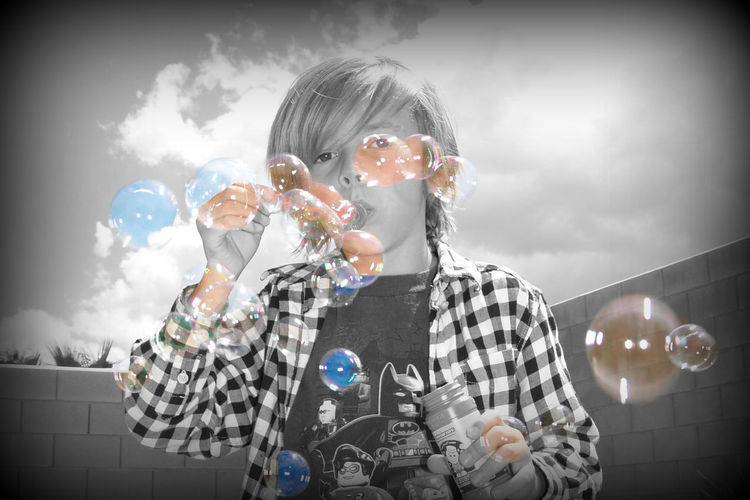 Black And White With A Splash Of Colour Blowing Bubbles Boy Childhood Play Eight Whimsical Bubbles