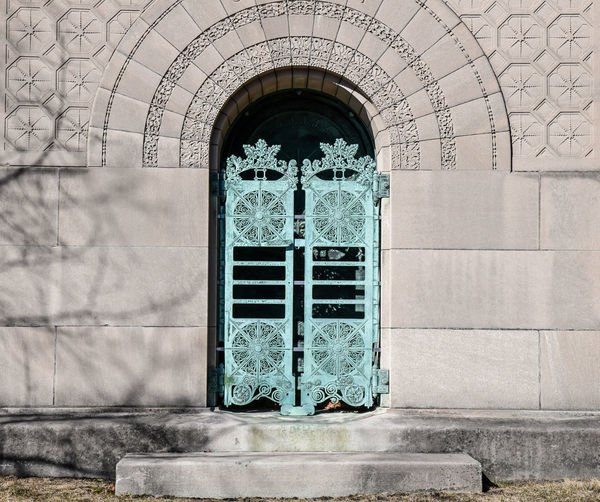 Historic city graveyard green patina doors
