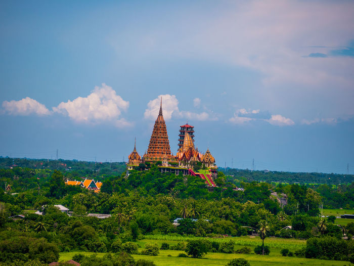 Thai view Sky Built Structure Religion Plant Belief Architecture Cloud - Sky Spirituality Building Place Of Worship Building Exterior Nature Tree No People Landscape Growth The Past Green Color Outdoors Spire