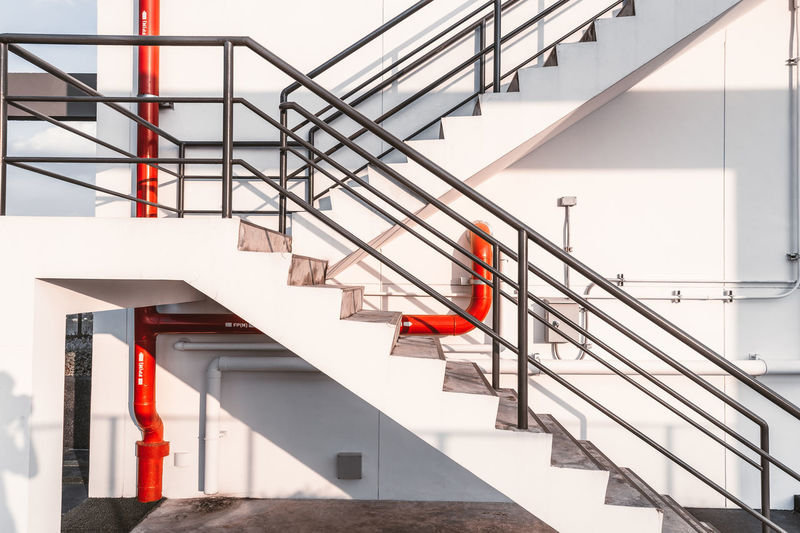 Architecture Building Building Exterior Built Structure Day Modern Nature No People Outdoors Protection Railing Red Safety Security Staircase Steps And Staircases Sunlight Wall - Building Feature White Color