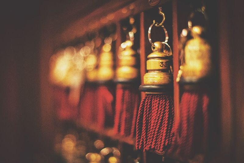 Close-up of tassel hanging in shelves