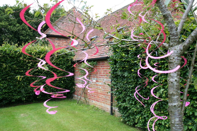 Pink Swirls In The Garden. Architecture Building Exterior Built Structure Day Garden Party Garden Photography Grass Green Color Nature No People Old Buildings Outdoors Pink Color Pink Decorations Pink Party Pink Swirls Tree
