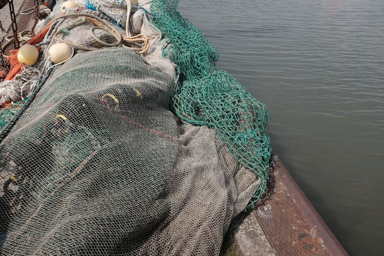 High angle view of fishing net in boat on sea