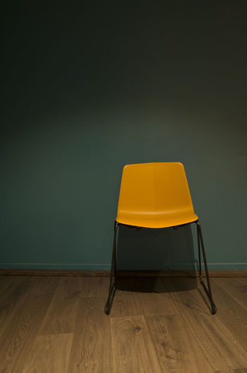 Empty chair on table at home