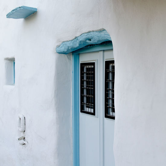 Architectural detail in Paros, Greece Paros Architecture Building Exterior Built Structure Cyclades Day Door Greece House Lefkes No People Outdoors Residential Building Stone Stone Wall Traditional White Color Whitewashed Window