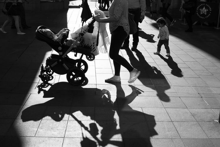 The Street Photographer - 2018 EyeEm Awards Body Part City Day Flooring Footpath Group Group Of People Lifestyles Low Section Medium Group Of People Men Motion Nature Outdoors Paving Stone People Real People Shadow Street Sunlight Tiled Floor Walking Women Moms & Dads