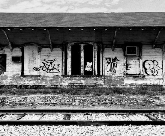 Graffiti Architecture Built Structure Railroad Track Building Exterior Day No People Rail Transportation Outdoors Abandoned Sorrow Southern Gothic Train Station Black & White Cold Final Departure Absence Long Goodbye Longing Loss Parted Separation Cold And Hard Restricted Restraint