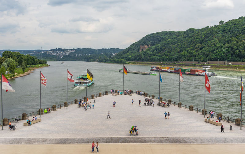High angle view of people on pier against sky