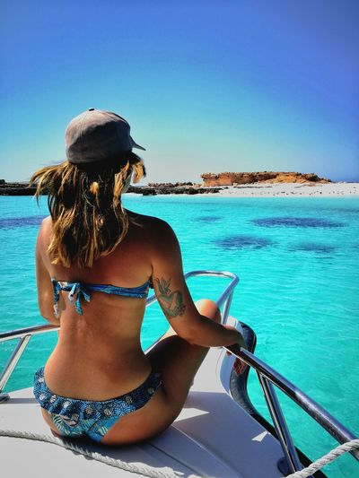 Sea Bikini Only Women Beach Water Summer One Person Adults Only Rear View Adult Vacations One Woman Only People Leisure Activity Lifestyles Sky Nature Nautical Vessel Outdoors Women