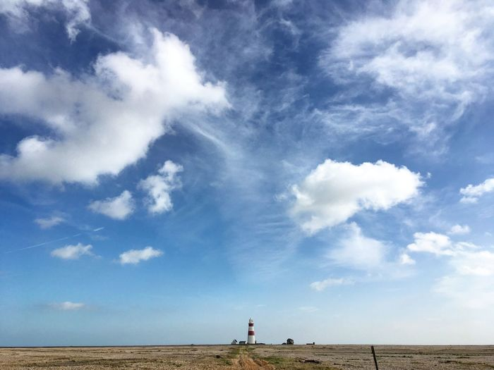 Beakon Shore Lighthouse Sky Cloud - Sky Land Day Nature Real People Beauty In Nature Lifestyles Leisure Activity Incidental People Tranquility Beach Tranquil Scene Scenics - Nature People Outdoors Water Environment Men The Great Outdoors - 2018 EyeEm Awards