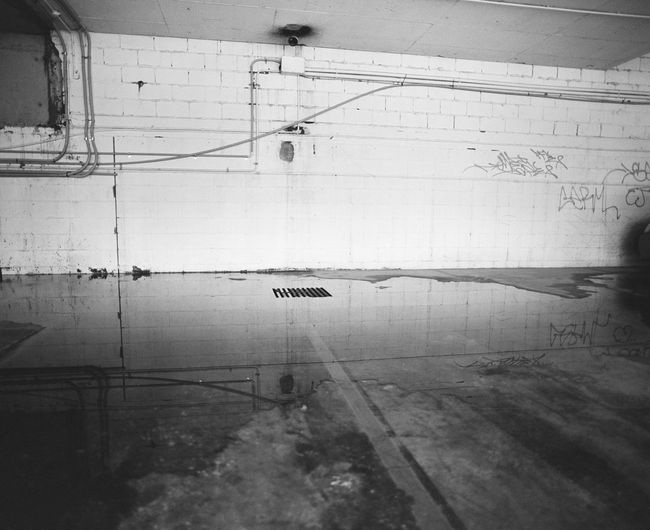 Car park reflections Blackandwhite Mediumformatfilm Carpark No People Transportation Reflection Water Wet Architecture Built Structure Wall - Building Feature Textured