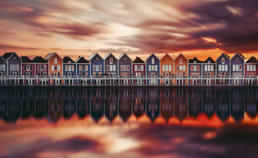 Amsterdam Houten Holland Dutch Reflection Sun Remo SCarfo Cloud - Sky Sky Water Built Structure Sunset Architecture No People Nature Building Exterior Orange Color Building Dusk Beauty In Nature In A Row Outdoors Scenics - Nature Dramatic Sky Side By Side