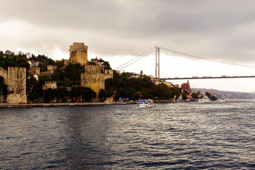 Rumeli Hisari Architecture Bridge - Man Made Structure Built Structure Castle, Fortress, Protection, Fort, Security, Ancient, Dominating Cloud Cloud - Sky Cloudy Connection Day Engineering Fortress, Fort, Stronghold, Fortification, Keep, Citadel Nature Outdoors Rippled River Rumeli Hisarı Rumelihisari Scenics Sky Suspension Bridge Tranquil Scene Travel Destinations Turkey, Istanbul, Europe, European, Asia, Asian, Bosphorous, Water, Black Sea, Sea, Water Waterfront