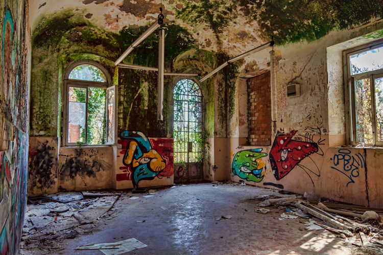 Window Architecture Damaged Abandoned Built Structure Obsolete Building Run-down Graffiti Day No People Bad Condition Old Decline Deterioration Indoors  Weathered Messy Ruined Flooring Dirty Mental Hospital