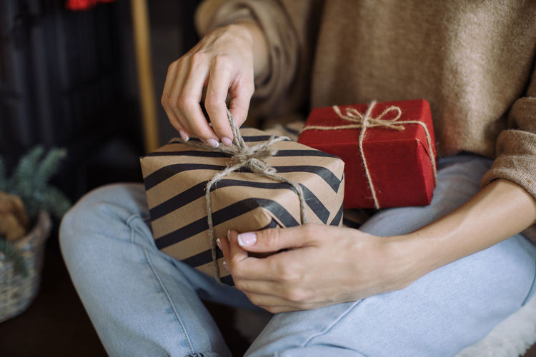 Midsection of woman holding gifts box