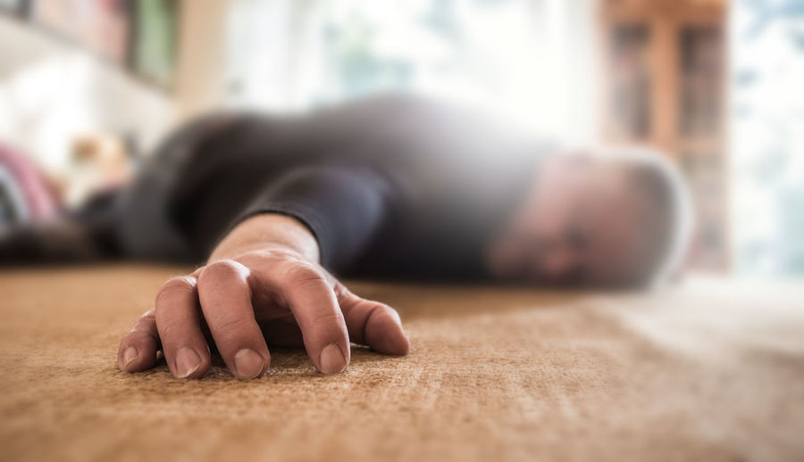 Close-up of man sleeping on floor