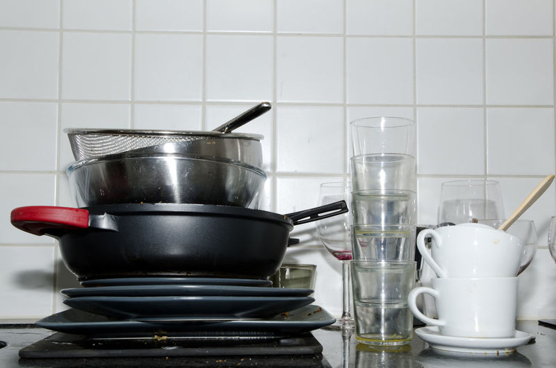 Stack Of Utensils On Kitchen Counter