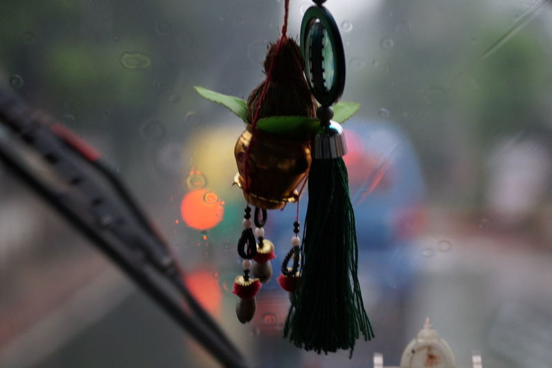 Close-up of hangings against blurred background