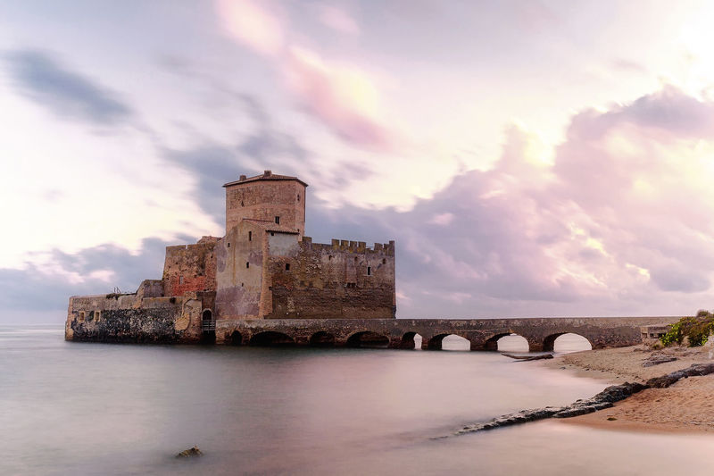 Castle in sea during sunset at lazio