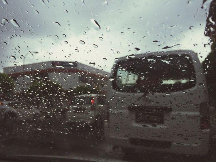 Taking Photos As The Rain Falls