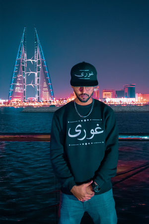 after hours lit Seashore Skyscraper Skyline Merchandise HipHop HipHopStyle Arab Caligraphy Arabic Style Arabian neon life Neon Lights Glow One Man Only Mature Adult One Person Only Men Adults Only Night Portrait Sky