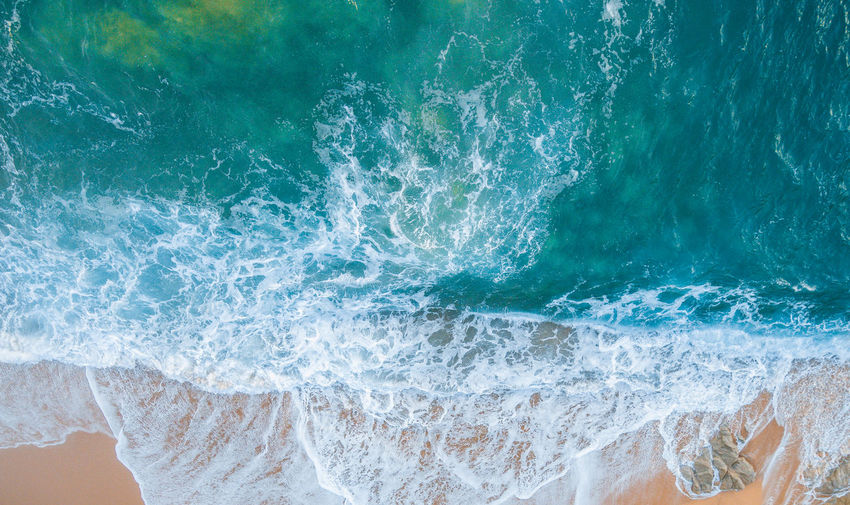 High angle view of wave splashing on shore