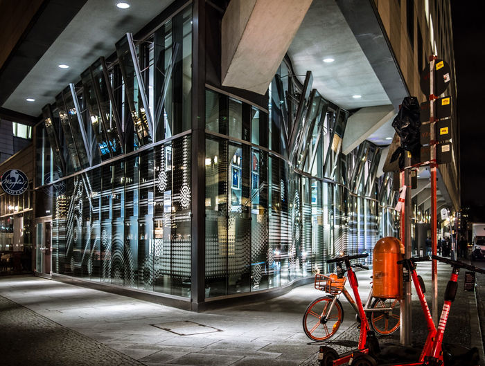 Bicycles in illuminated building at night