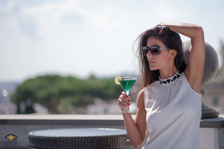 Drinking One Woman Only Drink Only Women Refreshment Drinking Glass Food And Drink Women Adult Adults Only Alcohol Holding Water People Wineglass One Person Outdoors Drinking Water Cocktail Precious Gem Fashionable Beauty Model Sunglasses Photography