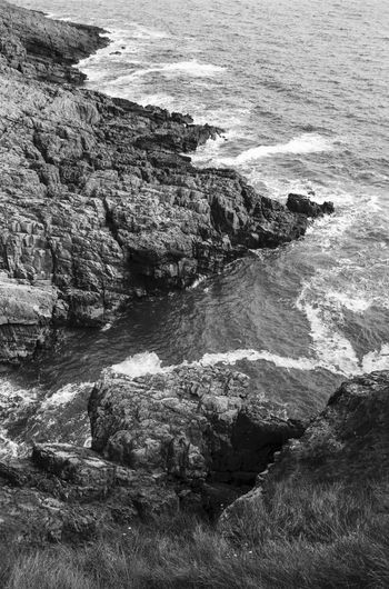 please feel free to see more at vsco.co/idimarco Beach Beauty In Nature Blackandwhite Cliff Day From Above  Landscape Langland Bay Natural Landmark Nature Non-urban Scene Outdoors Rock - Object Rock Formation Scenics Sea Shore Tourism Tranquil Scene Tranquility Travel Destinations Vacations Vertical Composition Wales Water