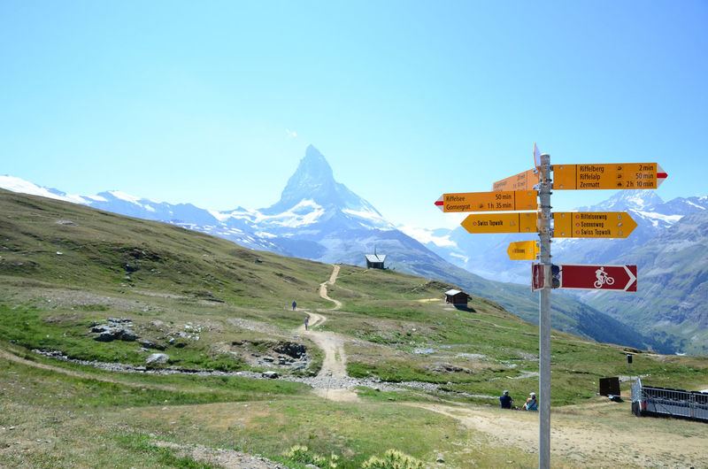 Sign Zermatt Adventure Beauty In Nature Clear Sky Day Grass Hike Landscape Mountain Nature No People Outdoors Road Sign Scenics Sky Swiss Alps Swiss Mountains Trail