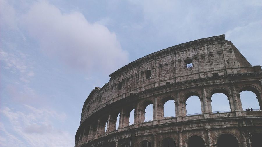 Low angle view colosseum against the sky at rome