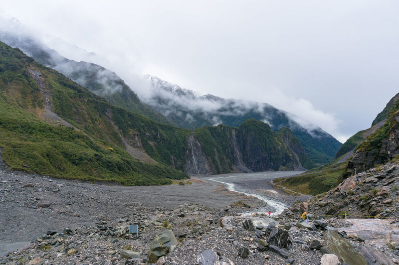 Fox glacier valley landscape with low clouds. hiking in new zealand