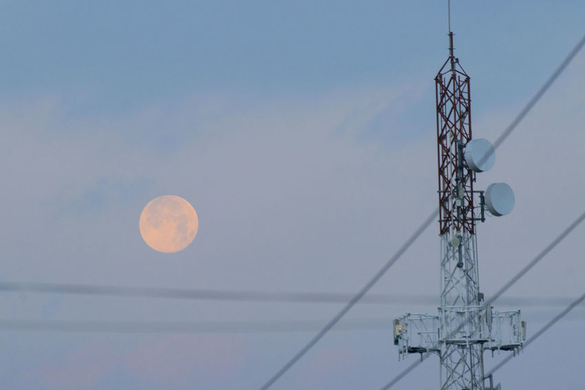 View of the full moon at dawn. Astronomy Day Low Angle View Moon Nature No People Outdoors Sky