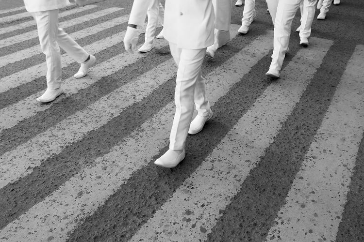 Trainees marching on the street Marching Streetphotography Streetstyle Streetrepeat Streetphotodaily Street Streetphoto_bw Blackandwhite Blackandwhitephotography Instablackandwhite Bnwphotography Bnw March EyeEm eyeemphoto Pattern EyeEm Selects EyeEm Streets Low Section Togetherness Men Wedding Walking Human Foot Feet Shoe Footwear Personal Perspective