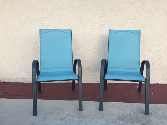 Two turquoise chairs in a pool area Empty nNo People bBlue SSummertime sSummer sSeats tTurquoise pPool Chairs pPool Area cChairs Seats cChairs CChair bBuilding Exterior AArchitecture dDay