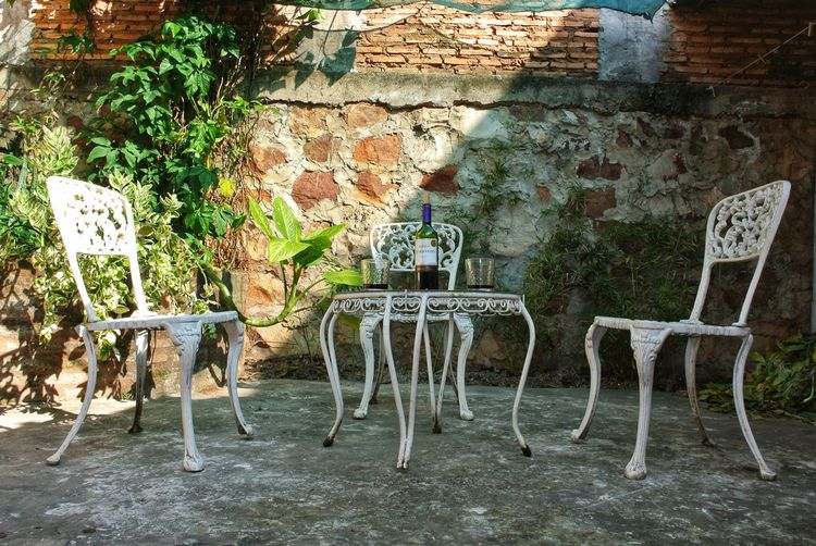 Chairs and table against wall