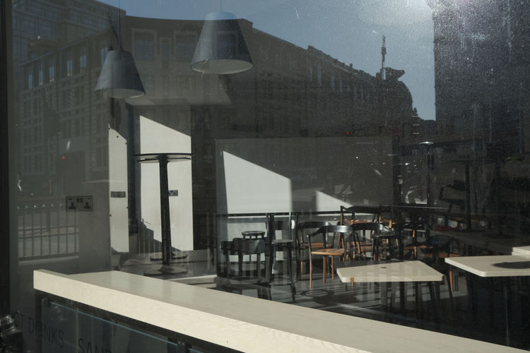 View of restaurant by buildings in city