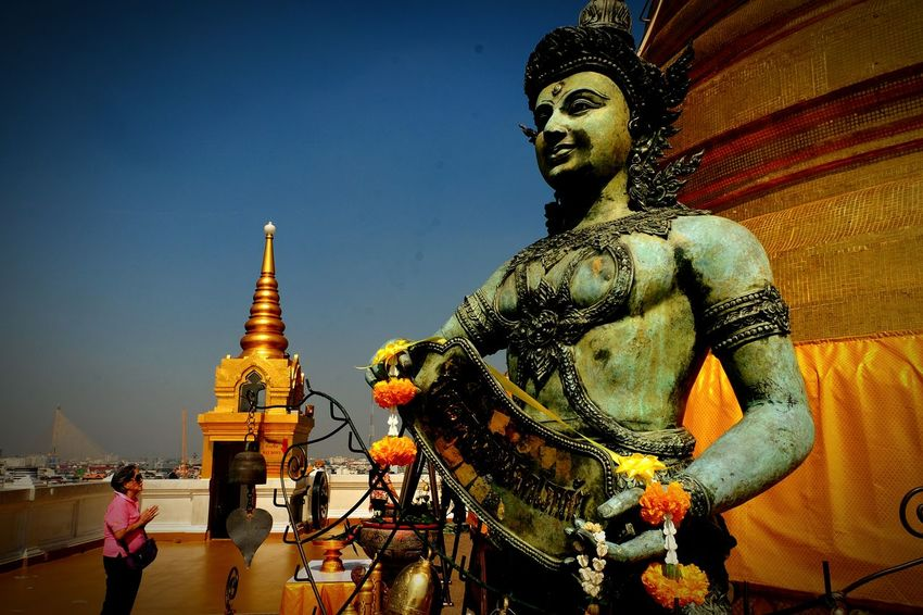 Religion Statue Pagoda Spirituality Ancient Architecture History Arts Culture And Entertainment Travel Destinations One Person Gold Colored Gold Outdoors Buddha Temple Buddha Temple, Thailand Outdoor Photography Travel Bangkok Thailand. Ancient Place Of Worship EyeEmNewHere