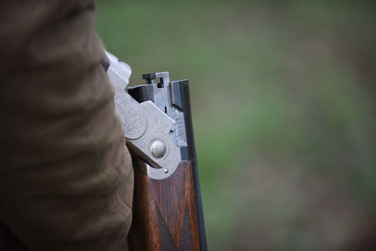 Weapon Real People One Person Close-up Day Men Outdoors Shooting Shotgun Country Country Life Field Clay Pigeon Gun