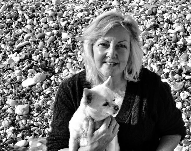 High Angle Portrait Of Woman With Dog At Beach
