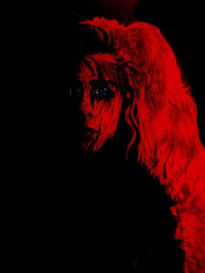 Portrait of red man against black background