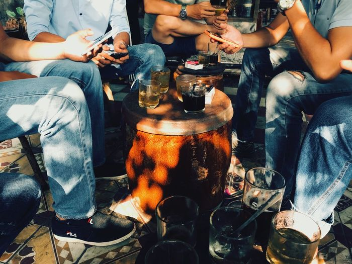 Coffee time Sunlight Coffee Time Coffee Morning Drink Alcohol Sitting Friendship Real People Togetherness Men Drinking Table Low Section Adult Lifestyles People Day Happy Hour Group Of People Indoors  Modern Workplace Culture Focus On The Story Modern Hospitality Human Connection