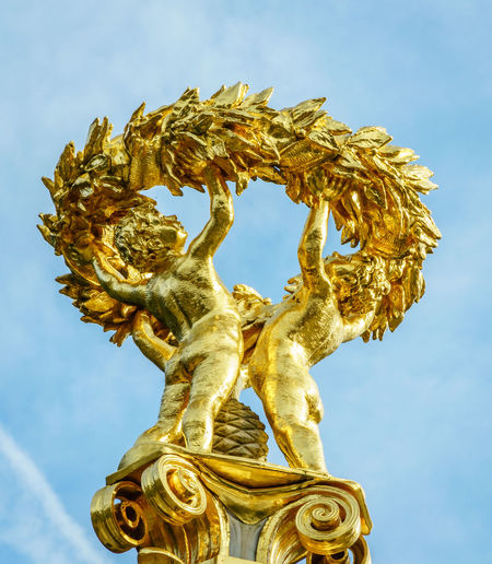 Art And Craft Gold Colored Sculpture Sky Statue No People Creativity Low Angle View Human Representation Cloud - Sky Representation Gold Day Nature Female Likeness Craft Focus On Foreground Outdoors Angel Male Likeness Ornate Gilded