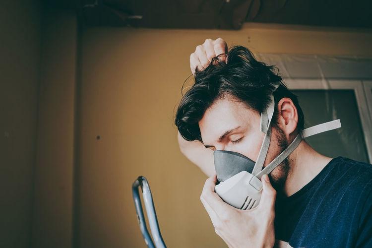 Close-up of man wearing gas mask