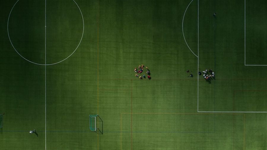 Directly above shot of people playing soccer on field