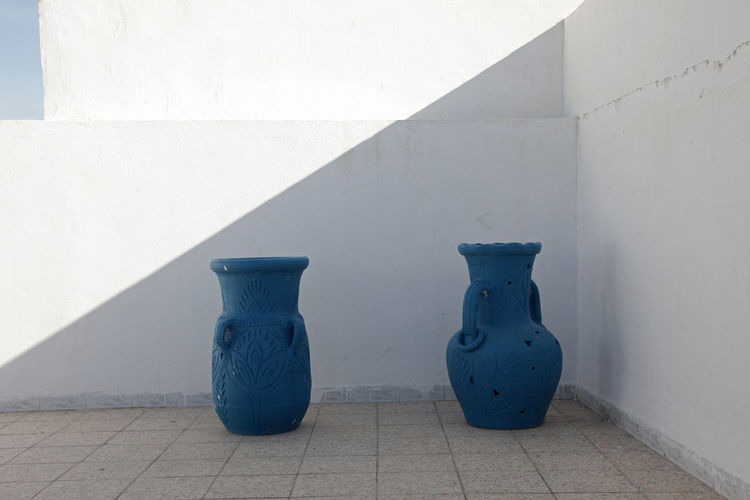 Jugs in front of a white wall Africa Amphora Blue Built Structure Ceramic City Craft Culture Decorative Handmade Jug Kairouan Ornament Town Tunisia Wall Wall - Building Feature White