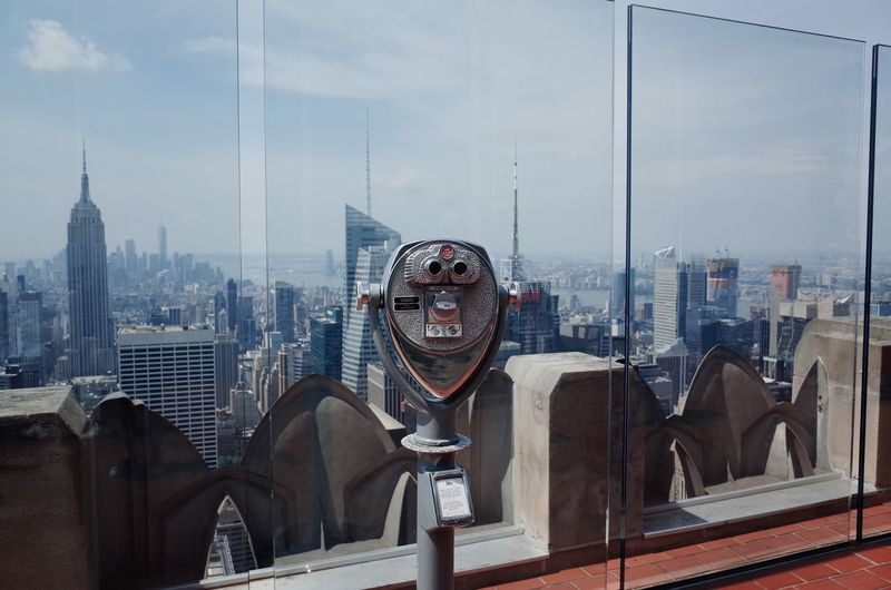 Coin-Operated Binoculars In Building Against Sky