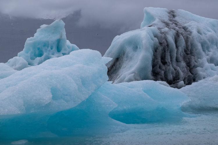 Scenic View Of Iceberg In Sea