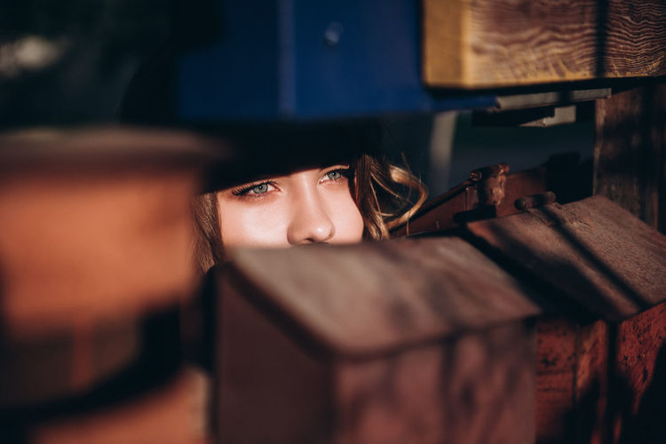 Close-up of young woman looking through mailbox